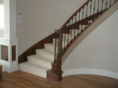 wrought iron balusters wrought iron balusters wrought black iron baluster including brown solid wood handrail and