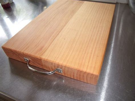Images Kitchen Islands chopping board with stainless steel handle handmade in