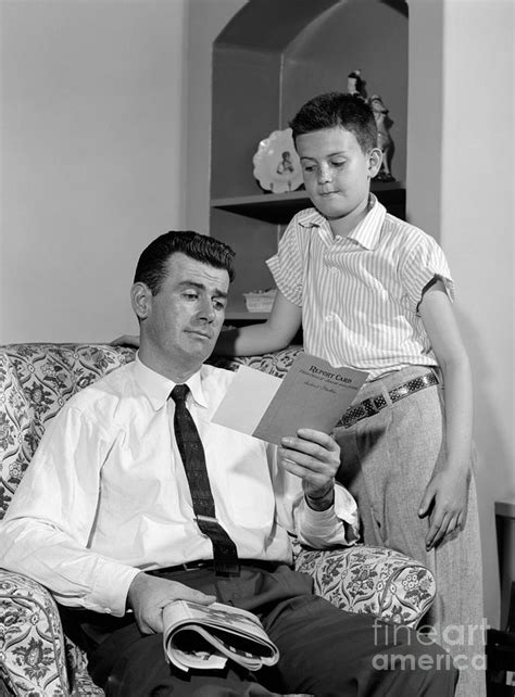 Father With Boys Report Card, C.1950s Photograph by H