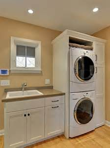 An awesome traditional laundry room with a stacked washer dryer