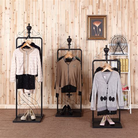 man and woman in the bedroom bedroom the metal clothes rack garment hanging stand