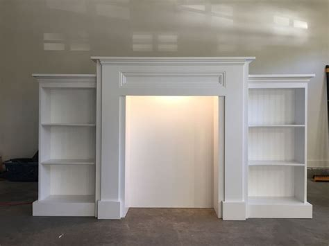 do it yourself bookshelves mimi s faux mantle with bookshelves do it yourself home projects from white living room