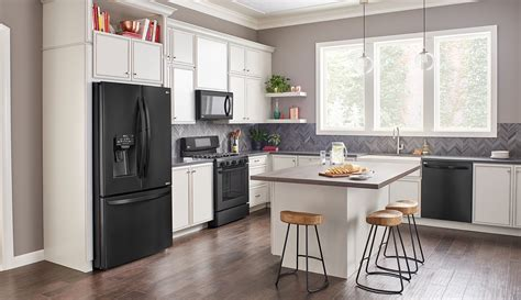 white kitchen cabinets black appliances black kitchen cabinets with stainless steel appliances 100