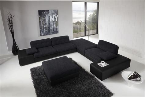 large black sofa for modern living room design with high ceiling ideas and using recent wall