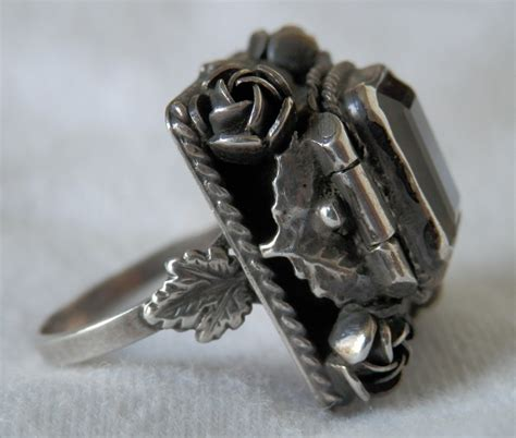 antique silver poison ring decorated with sythetic spinel