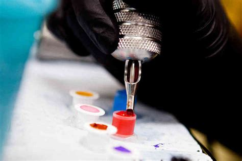 tattoo with pen ink and needle tattoo artists tattoo removal tattoo services