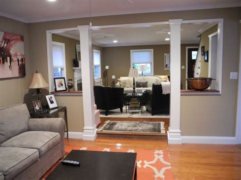 removing a wall between kitchen and living room neutral family room with pops of orange opens up into more formal living room living room