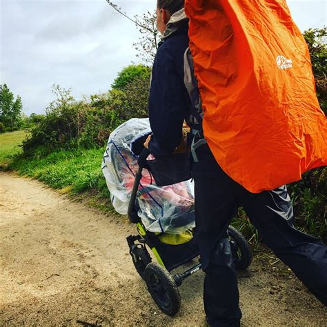woman hiking  baby   pram  camino de santiago