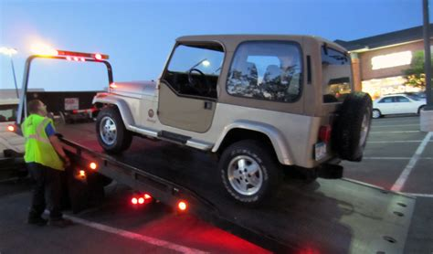 tow truck bed jeep on flat bed tow truck jurassic jeep 65 million years in the making