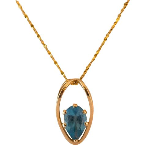 Is This Really A Gold Topaz by 14k Gold Blue Topaz Pendant With 17 Inch 14k Gold Chain