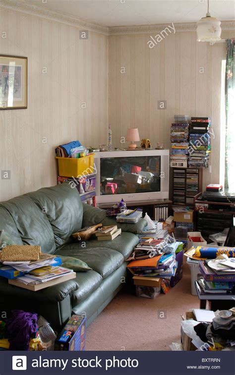 Room With Books And Untidy Cluttered Lounge Room With Books