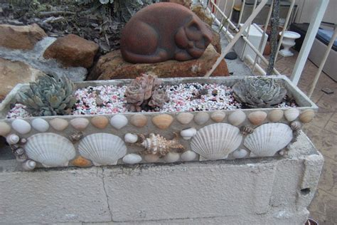 hometalk  shells  decorate flower pots