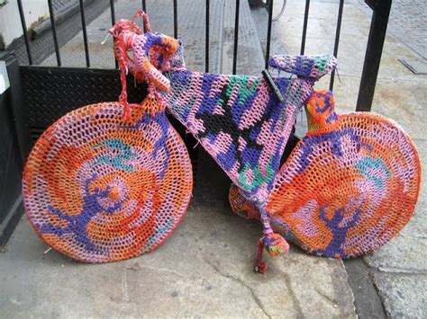 knitting vandalism yarn bombing guerilla knitters graffiti cover