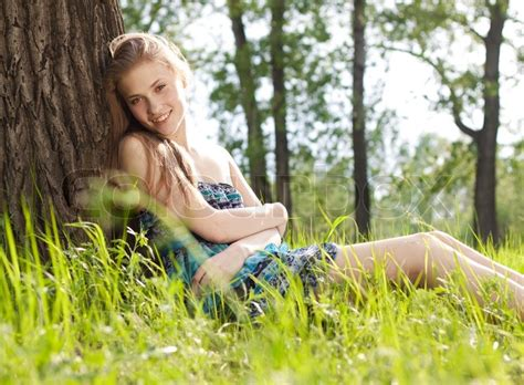 beautiful teen beautiful teen girl in blue dress on the meadow stock
