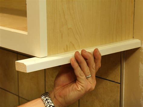 light rail molding for kitchen cabinets how to install a kitchen cabinet light rail how tos diy