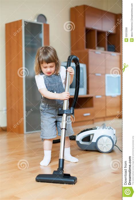Vacuum The Living Room In With Vacuum Cleaner Royalty Free Stock Photos Image