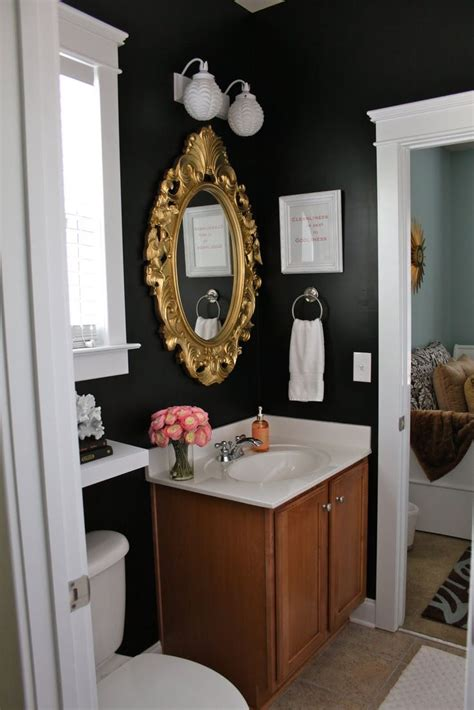 Black Walls In The Bathroom With Gold Framed Mirror Gold Bathroom Mirror