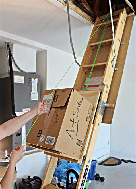 Garage Ladder Storage System by Best 25 Attic Lift Ideas On Garage Lift