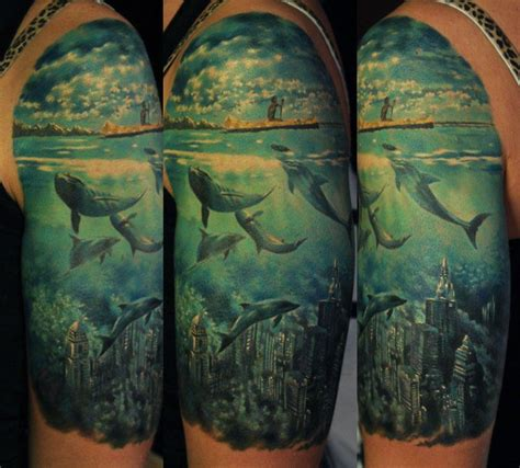 atlantis tattoo lost city of atlantis with dolphins half sleeve inked