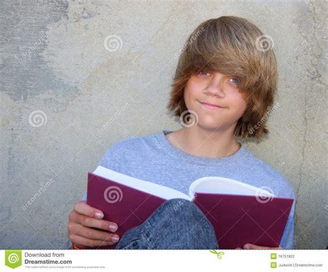 cute teen boy stock photos pictures royalty free cute teen boy with book stock photo image of blonde school