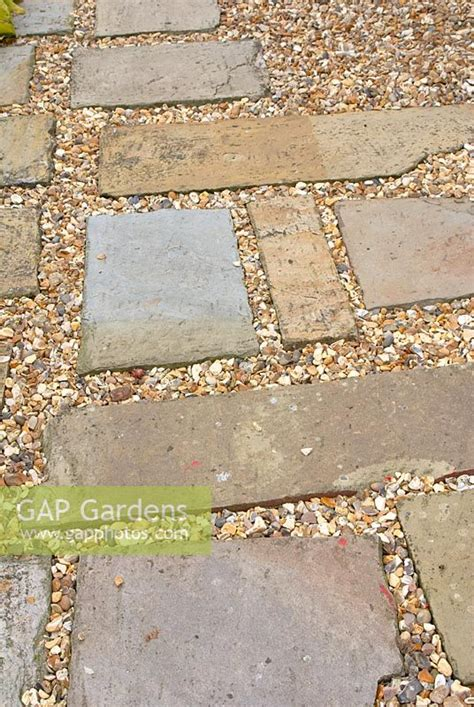 gap gardens stone paving slabs and gravel path image no 0198292 photo by fiona lea