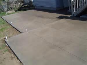 backyard patio with brushed finish buchheit construction