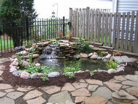 Backyard Pond Ideas With Waterfall Easy And Simple Backyard Landscaping House Design With Ponds Surrounded By Small Garden With