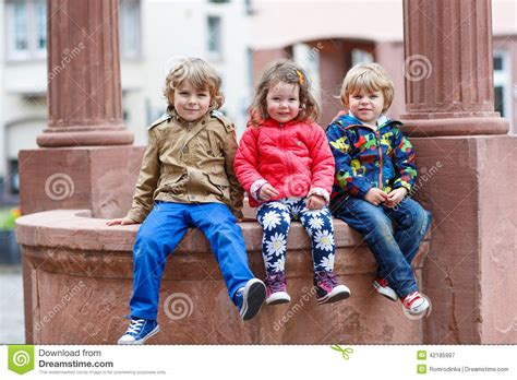 soap two girls and one boy three siblings sitting together on in city stock image image 42185997