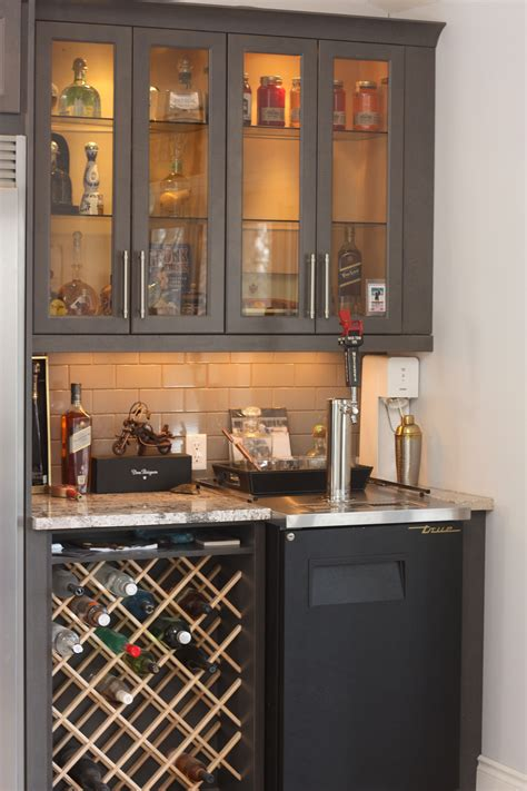 kitchen cabinet with wine glass rack custom wine rack in bar area with kegerator and glass door