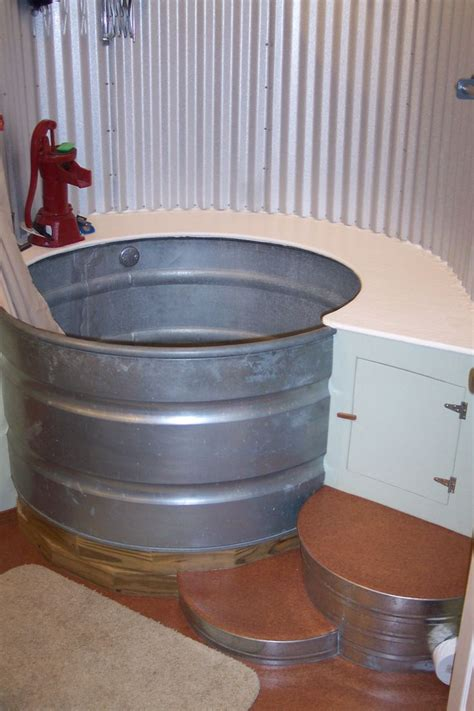stock tank bathtub tub and shower created from a stock tank from the mind