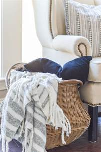 large basket for storing throw pillows 11 ways to use baskets for storage and decor in your home