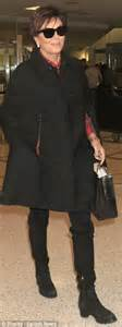 kris who turned 60 that day is set to celebrate her birthday on kris jenner wears a cape while touching down in la daily