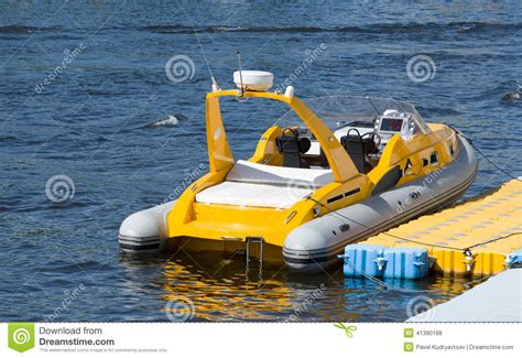 small boat motor a small inflatable boat stock photo image 41390188