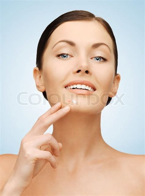 beauty smaller chins in women beautiful woman pointing to chin stock photo colourbox