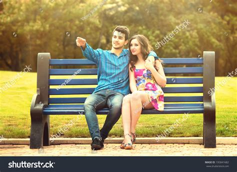couple sitting on bench young couple love sitting together on stock photo