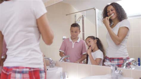 bathroom pov 4k little girl in bathroom cleaning her teeth as seen