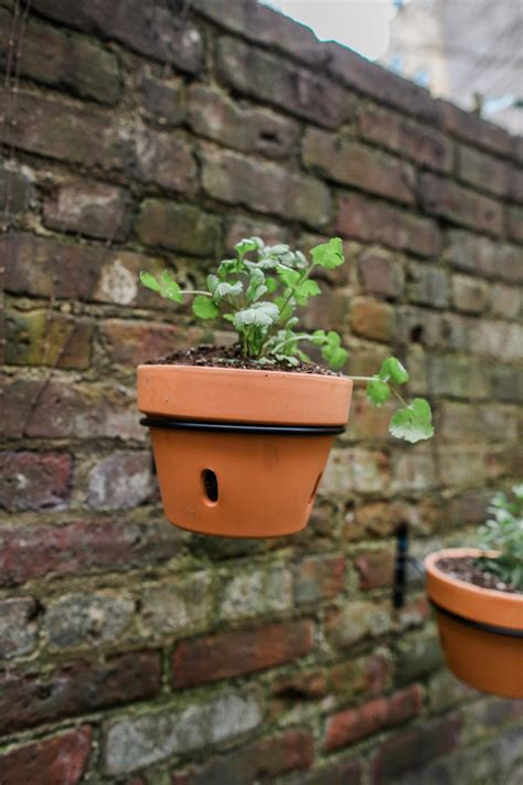 diy urban patio makeover hanging planters terra cotta