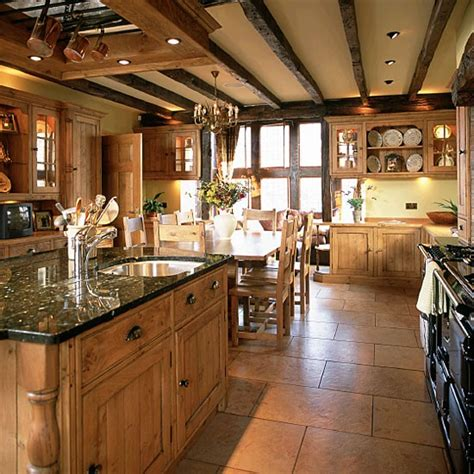 country kitchen tile ideas country kitchen with wooden units and beams housetohome