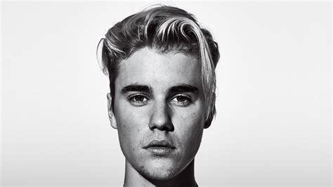 justin bieber gq tattoo justin bieber s personal decoder for his many many