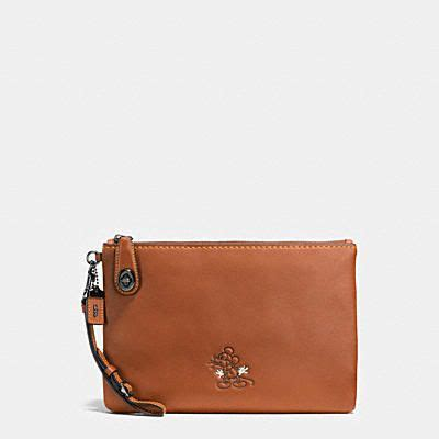 minnie mouse coach wristlet mickey turnlock wristlet in glovetanned leather mickey