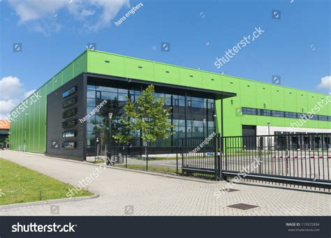 modern warehouse design modern green warehouse rotterdam harbor area stock photo