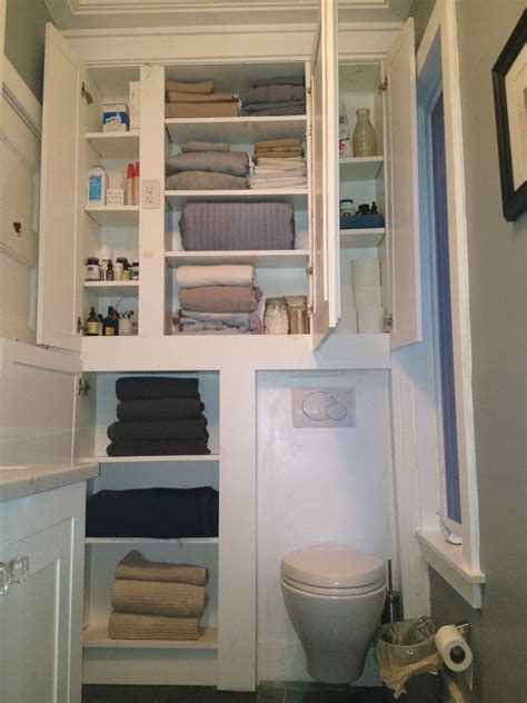 small towel cabinet white wooden towel cabinet over toilet in gray painted