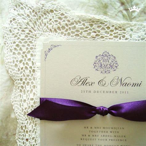 tie ribbon around wedding invitation grape caramel a5 flat invitation with a brooche design