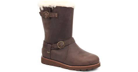 ugg noira sheepskin lined leather boots in brown lyst