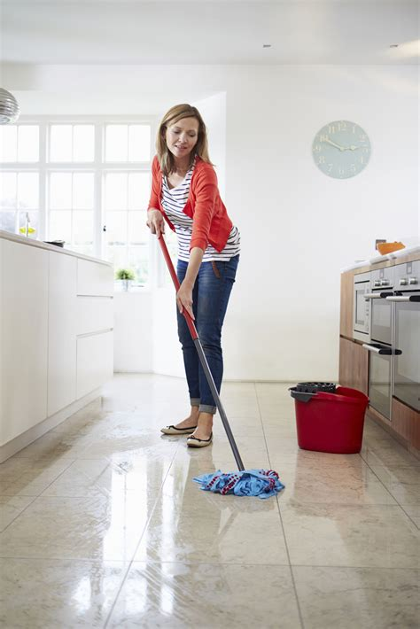 Mopping Bathroom Floor by 4 Kitchen Flooring Options You Need To About