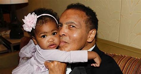 muhammad ali children s biography muhammad ali kisses baby granddaughter in touching family