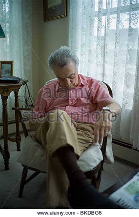 sleeping in the living room old man sleeping chair stock photos old man sleeping