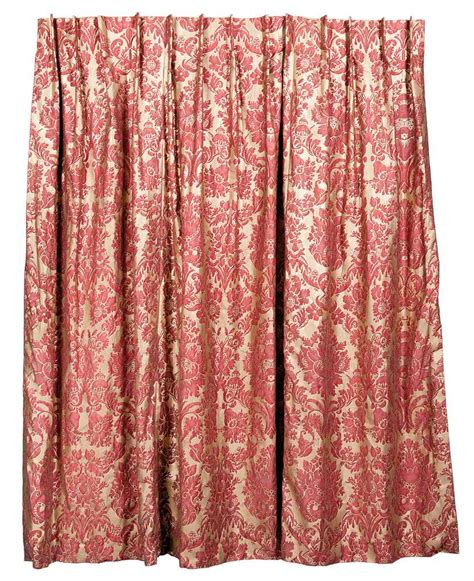 A Set Of Three Red And Gold Damask Printed Curtains