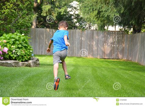 Backyard In Boy Running Outside In Backyard Stock Photo Image 57323582