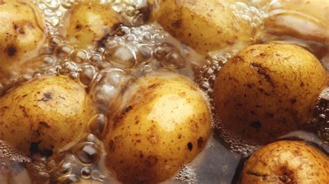 how long does it take to boil whole potatoes reference com